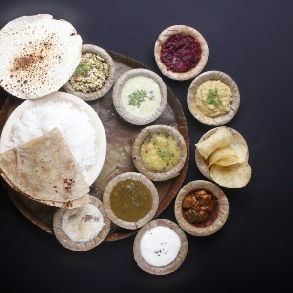 indian-food-with-chapatti-rice-curries-vegetables-papad-pickle-payasam-f4